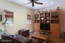 Note the recessed lights and the ceiling fan