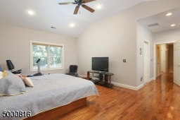 Note the recessed lights and ceiling fan