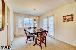 Formal Dining Room is sunlit by a large picture window that overlooks the backyard.