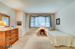 The Second Bedroom is generous in size and sunlit with a large picture window, features two closets.