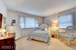 The Master Bedroom is spacious, features a front picture window, plus side window and double closet.