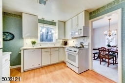 Located conveniently adjacent to the Dining Room, is a light, bright Kitchen.