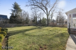 A level backyard with mature landscaping with perennials and shrubs to delight all year.