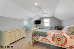 This second floor bedroom is spacious and has great storage in the double closet.