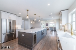 """Upscale chefs kitchen  with 48"""" stove, designer hood, wine fridge, undercounted microwave, french door refrigerator and more"""