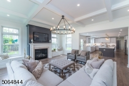 Family room open to kitchen floor to ceiling fireplace and 14 foot coffered ceiling