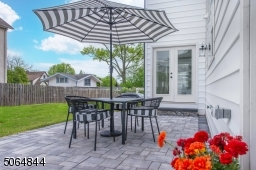 Backyard patio off kitchen and double doors from dining room