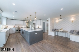 Loads of cabinets, walk in pantry and cozy comfortable sit down eating nook
