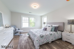 One of 4/5 bedrooms on second floor. This bedroom has its own ensuite full bath (not shown)