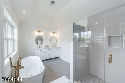 Master bath with two sinks, soaking tub, large walk in shower
