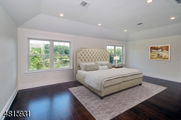 This Large bedroom is virtually staged to show you how spacious it is.