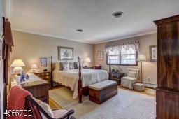 "Master Bedroom is 14'.6"" x 14'.8"" with a 7'.4"" x 4'.6"" walk-in closet. Oak flooring."