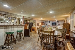 """Recreation room is 25'.4"""" x 32' with a bar area of 6'.6"""" x 7'.5"""".Electric heat in basement."""