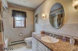 """Main bath has a deep tub 20"""" x 60"""" x 30"""" and shower."""