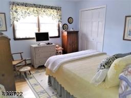 """Second bedroom is 11'.4"""" x 12' x 12.4"""". Oak wood flooring."""