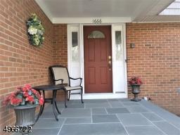 Open Bluestone Front Porch and Entrance. Retractable front screen door also in side garage door and basement bilco door.