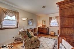"Third Bedroom is 12'.3"" x 11.9"". Oak wood flooring."