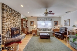Family Room is 16' x 16'. Stone wall with a gas fireplace and oak wood flooring. Central vacuum connection.