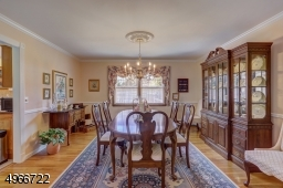 """Formal dining room is 13' x 14"""" with oak flooring. Chandelier is to be replaced. Central vacuum connection."""