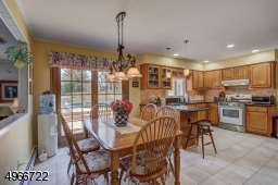"""Eat-in Kitchen is 13'. 19'.5"""". Sliders leading to double tier trex deck."""