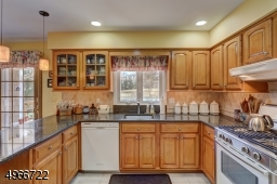 Plenty of maple cabinets and quartz countertops.