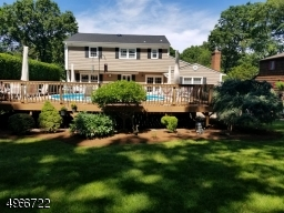 """Great for entertaining. This two tier trex wood deck is 32"""" x 45' with above ground pool in upper deck, electric awning in lower deck and deck lighting,"""