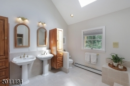 So much space in this master bathroom. Skylights and soaring ceilings.