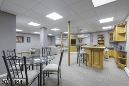 WOW!  It just doesn't get more spacious, fun or rec room perfect than this.  Wet bar, game area, lounge area, 2 finished rooms that can be used for an exercise room or craft room!