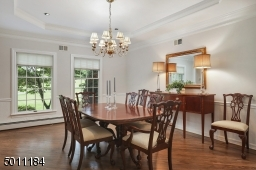 Beautiful tray ceilings, newly finished wood floors and freshly painted wall give this dining room the desire to entertain today!