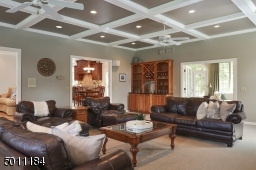 This huge room with wet bar is so perfect for entertaining!  With this open floor plan you have great flow to and from the conservatory as well.