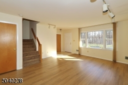 New Vinyl Flooring & Park-Like Views with Exit to Front