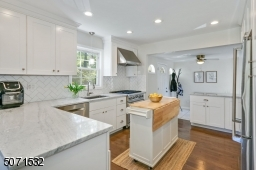 Completely Updated in 2020; Granite Counters; New Hardwood Floors; Center Island Not Included