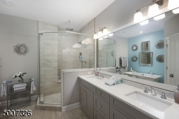 Beautifully coordinated with with the master bedroom. The bathroom also was upgraded to Quartz counter tops.