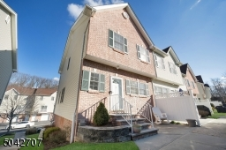 Beautiful End-unit Multi-level 2 Bedroom Townhome with a Master Bedroom Suite and 3.1 Baths. Spacious Home Office/Exercise/Studio on the Ground Level. Attached, Direct Access Garage  Nice Location, Convenient to NYC Transportation.