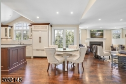 A tremendous open concept Family Room / Gourmet Chef?s Eat-In Kitchen with top-of-the-line WoodMode custom cabinetry, high-end appliances and center island seating.