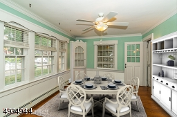 Dining room with built-ins (virtually staged)