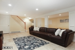 Family room with Wet Bar with Schuler Cabinetry, Granite CountertopRecessed Lighting, Half Bathroom,