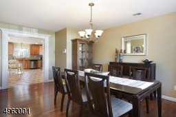 Formal dining room opens to a spacious kitchen