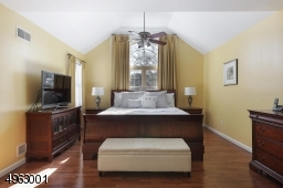 Magnificent master suite with cathedral ceilings and two walk in closets.