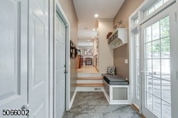 Heated Floor with Direct Access to Garage & Patio.