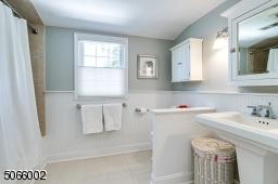 Pedestal Sink with Tub & Shower.