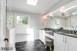 Marble Shower, Two Sinks & Center Vanity