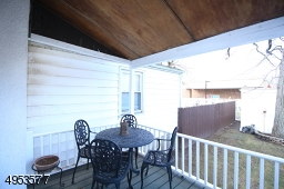 Enjoy outdoor dining on your covered back porch