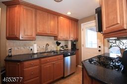 Updated Kitchen features plenty of cabinet space, undermount sink, dishwasher, newer garbage disposal