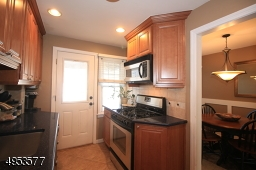 Another view of Kitchen, showing adjacent Dining Room.  Gas range, Microwave, and Refrigerator are included