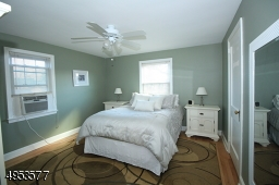 Large MBR can accommodate queen or king bed; 2 window exposures; hardwood floors; newer ceiling fan