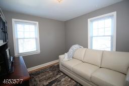 Second Bedroom, currently being used as Den; windows on 2 exposures; hardwood floor, closet