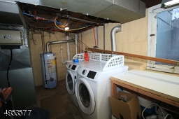 Newer front-load washer/dryer pair -- included in sale.  This portion of the basement also serves as a utility room/work shop.  Large window for natural light