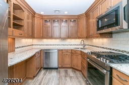 Beautifully updated kitchen with amazing cabinet space, quartz countertops and s/s appliances.