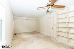 Great size room with walk-in closet and built in shelving.